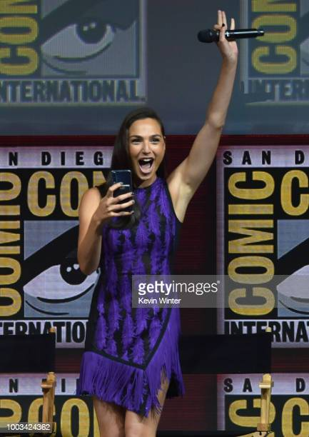 Gal Gadot walks onstage at the Warner Bros theatrical panel during ComicCon International 2018 at San Diego Convention Center on July 21 2018 in San...