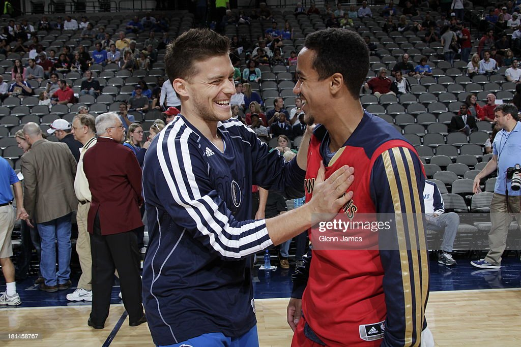 Gal Mekel #33 of the Dallas Mavericks shakes hands with Brian Roberts #22 of the New Orleans Pelicans on October 7, 2013 at the American Airlines Center in Dallas, Texas.