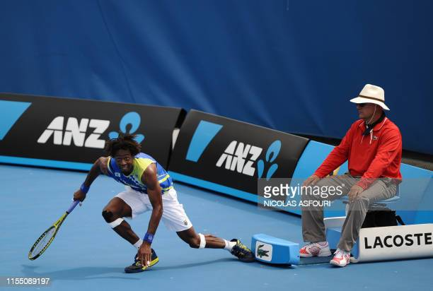 Gaël Monfils of France prepares to chase a ball during his men's singles match against Marinko Matosevic of Australia on the second day of the...