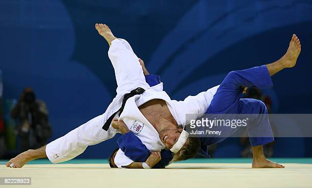 Gal Yekutiel of Israel takes on Craig Fallon of Great Britain during the men's 60kg repechage judo held at the Beijing Science and Technology...