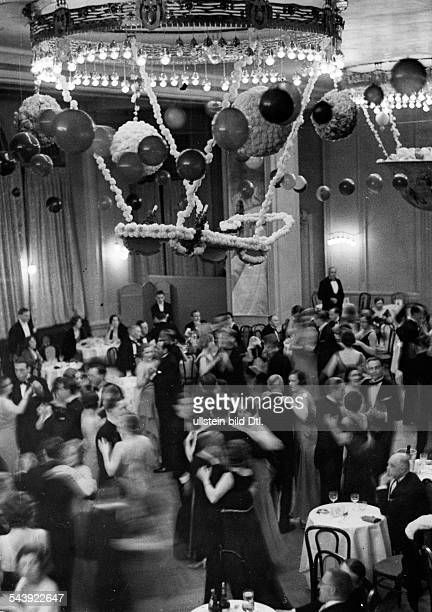 Gala Evening at the Grand Hotel: People dancing in the ballroom - Photographer: Alfred Eisenstaedt- Published by: 'Die Dame' 07/1931Vintage property...