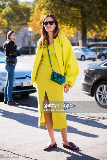 Gala Gonzales wearing a neon yellow top and skirt a matching neon yellow jacket a green Rochas crossbody bag and snake print shoes is seen before the...
