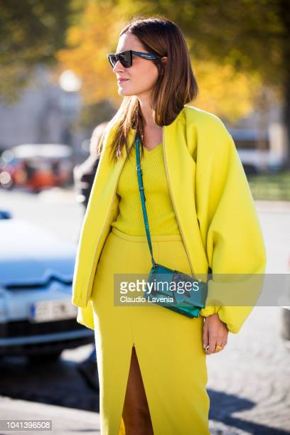 Gala Gonzales wearing a neon yellow top and skirt a matching neon yellow jacket and a green Rochas crossbody bag is seen before the Rochas show on...