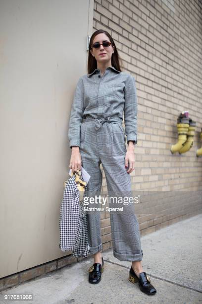 Gala Gonzalez is seen on the street attending Ralph Lauren during New York Fashion Week wearing a grey plaid jumpsuit on February 12 2018 in New York...