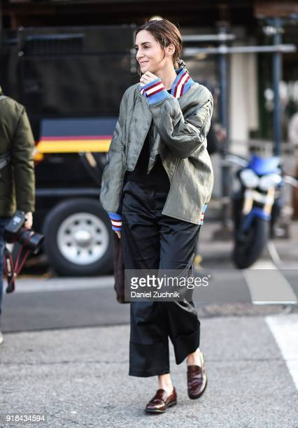 Gala Gonzalez is seen wearing a varsity jacket black top and pants with a brown and white fur bag outside the Esteban Cortazar show during New York...