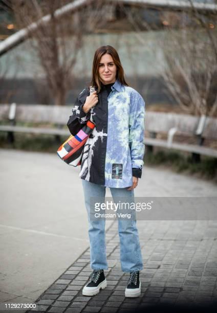 Gala Gonzalez is seen wearing denim jeans two tone shirt outside Proenza Schouler during New York Fashion Week Autumn Winter 2019 on February 11 2019...
