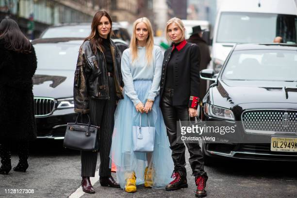 Gala Gonzalez is seen wearing leather jacket high waist striped pants Ralph Lauren bag Charlotte Groeneveld is seen wearing sheer skirt hoody bag and...
