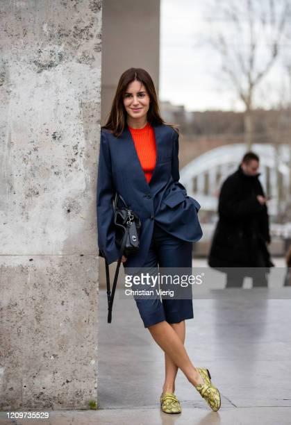 Gala Gonzalez is seen wearing navy shorts and blazer, black bag, orange jumper outside Elie Saab during Paris Fashion Week - Womenswear Fall/Winter...