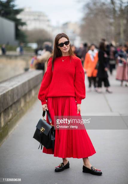 Gala Gonzalez is seen wearing red pleated skirt jumper outside Valentino during Paris Fashion Week Womenswear Fall/Winter 2019/2020 on March 03 2019...