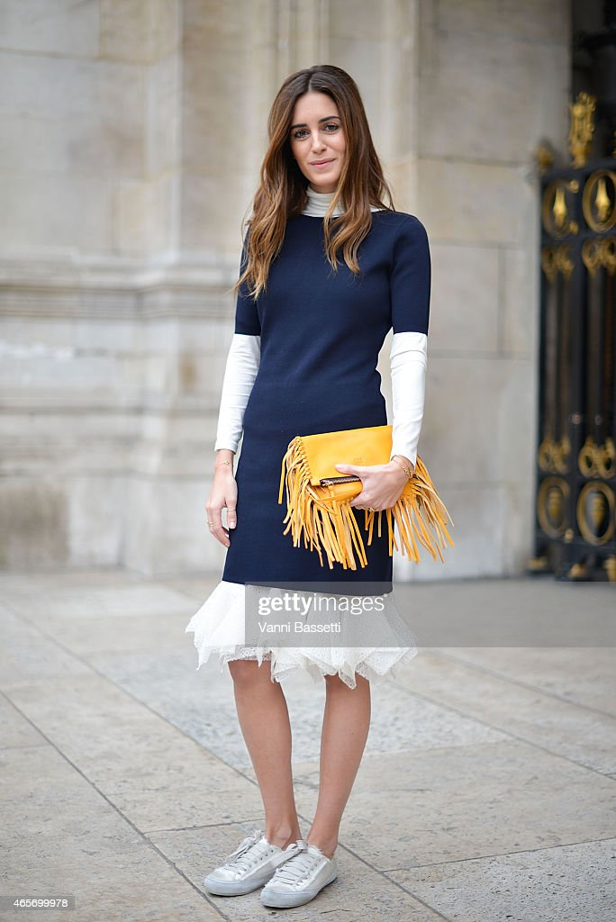 Gala Gonzalez poses wearing a Carolina Herrera dress and bag on Day 7 of Paris Fashion Week FW15 on March 9, 2015 in Paris, France.