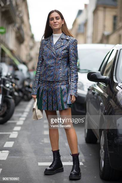 Gala Gonzalez poses wearing an Elie Saab dress and Dr Martens boots after the Elie Saab show at the Pavillion Cambon during Paris Fashion Week Haute...