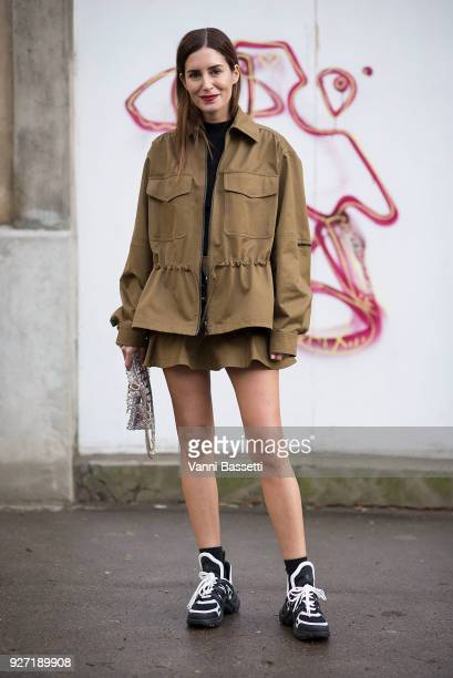 Gala Gonzalez poses wearing Louis Vuitton sneakers after the Valentino show at Les Invalides during Paris Fashion Week Womenswear FW 18/19 on March 4...