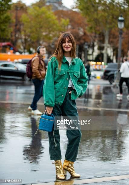 Gala Gonzalez seen wearing green button shirt blue Chanel bag pants golden ankle boots outside Chanel during Paris Fashion Week Womenswear Spring...