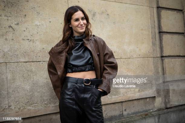 Gala Gonzalez wearing a black leather crop top black leather pants brown leather jacket and black boots is seen outside Elie Saab on Day 6 Paris...