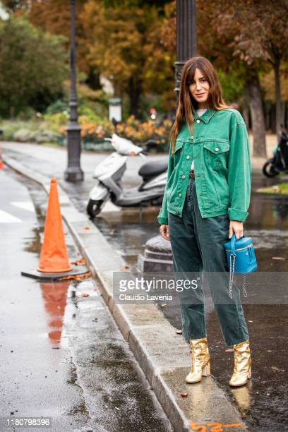Gala Gonzalez wearing a green denim jacket dark green jeans blue Chanel bag and gold boots is seen outside the Chanel show during Paris Fashion Week...