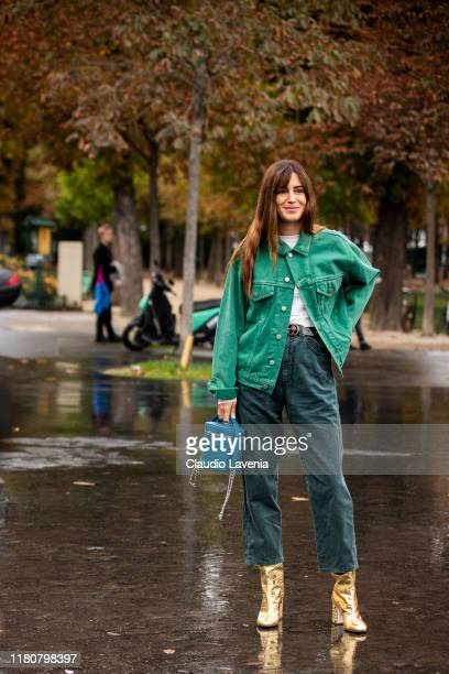 Gala Gonzalez, wearing a green denim jacket, dark green jeans, blue Chanel bag and gold boots, is seen outside the Chanel show during Paris Fashion...