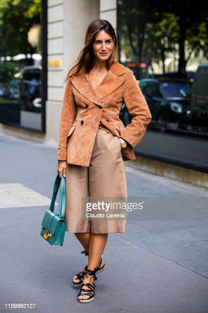 Gala Gonzalez wearing a light brown blazer beige pants black sandals and teal Dior bag is seen outside Christian Dior show during Paris Fashion Week...