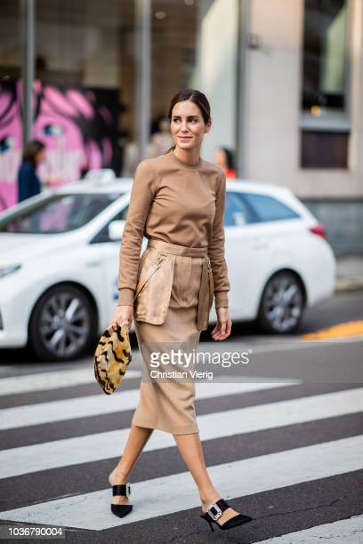 Gala Gonzalez wearing beige brown long shirt and skirt bag with animal print is seen outside Max Mara during Milan Fashion Week Spring/Summer 2019 on...