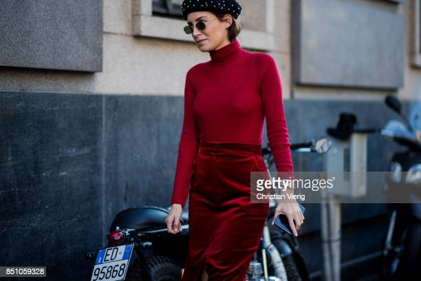 Gala Gonzalez wearing beret red turtleneck red velvet skirt is seen outside Max Mara during Milan Fashion Week Spring/Summer 2018 on September 21...