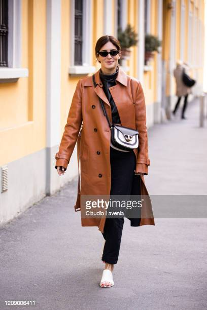 Gala Gonzalez wearing black leather top black pants Tod's bag white heels and tan leather jacket is seen outside Tod's show during Milan Fashion Week...