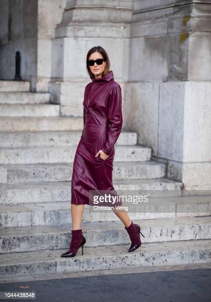 Gala Gonzalez wearing bordeaux leather coat ankle boots is seen outside Stella McCartney during Paris Fashion Week Womenswear Spring/Summer 2019 on...
