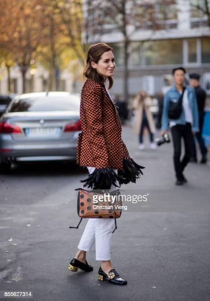 Gala Gonzalez wearing brown Loewe bag with dots print checked blazer white pants is seen outside Loewe during Paris Fashion Week Spring/Summer 2018...