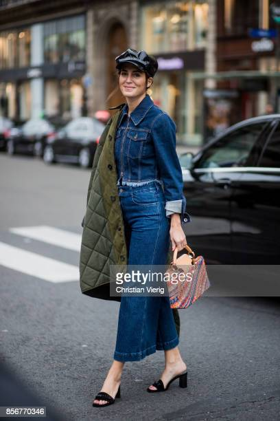 Gala Gonzalez wearing flat cap denim jacket cropped wide leg denim jeans seen outside Stella McCartney during Paris Fashion Week Spring/Summer 2018...