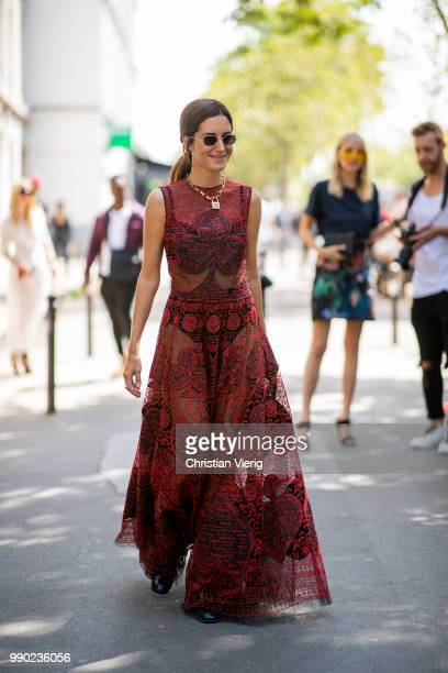 Gala Gonzalez wearing red dress Dior bag seen outside Dior on day two during Paris Fashion Week Haute Couture FW18 on July 2 2018 in Paris France