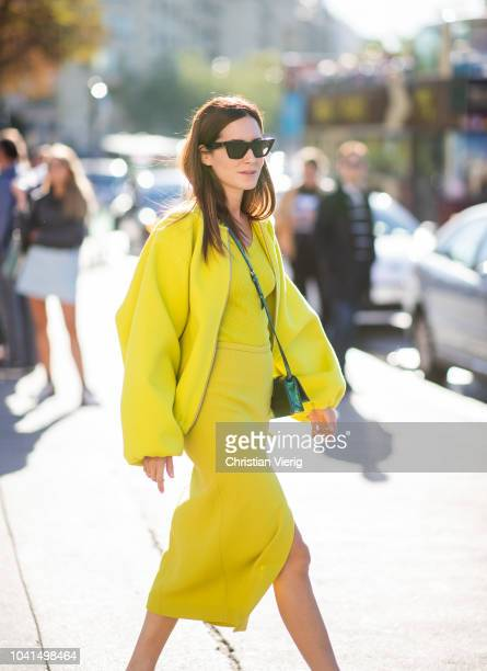 Gala Gonzalez wearing yellow jacket and dress is seen outside Rochas during Paris Fashion Week Womenswear Spring/Summer 2019 on September 26 2018 in...