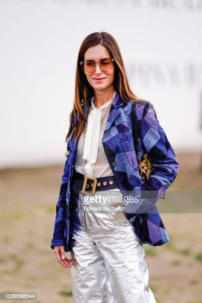 Gala Gonzalez wears a blue and purple printed blazer jacket a leather belt silver flare pants outside Dior during Paris Fashion Week Womenswear...