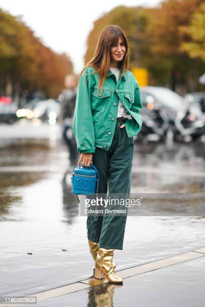 Gala Gonzalez wears a green denim jacket, a white top, green pants, golden boots, a blue Chanel bag, outside Chanel, during Paris Fashion Week -...