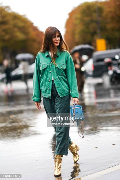 Gala Gonzalez wears a green denim jacket a white top green pants golden boots a blue Chanel bag outside Chanel during Paris Fashion Week Womenswear...