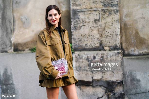 Gala Gonzalez wears a khaki jacket a skirt a bag outside Valentino during Paris Fashion Week Womenswear Fall/Winter 2018/2019 on March 4 2018 in...