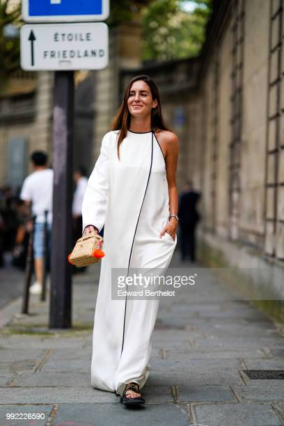 Gala Gonzalez wears a white offshoulder dress outside Valentino during Paris Fashion Week Haute Couture Fall Winter 2018/2019 on July 4 2018 in Paris...