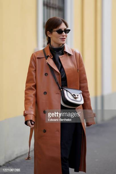 Gala Gonzalez wears sunglasses, a brown leather coat, a Tod's bag, black pants, outside Tod's, during Milan Fashion Week Fall/Winter 2020-2021 on...
