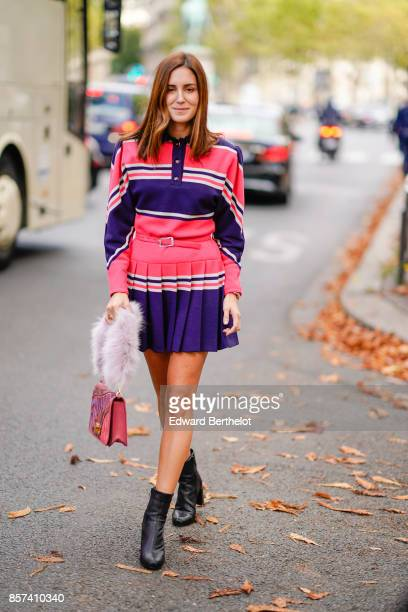 Gala Gonzalez weas a pink and purple striped dress outside Miu Miu during Paris Fashion Week Womenswear Spring/Summer 2018 on October 3 2017 in Paris...
