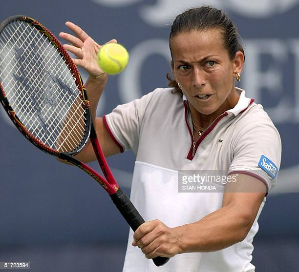Gala Leon Garcia of Spain returns a backhand to Sandrine Testud of France during their second round match with at the US Open at Flushing Meadows New...
