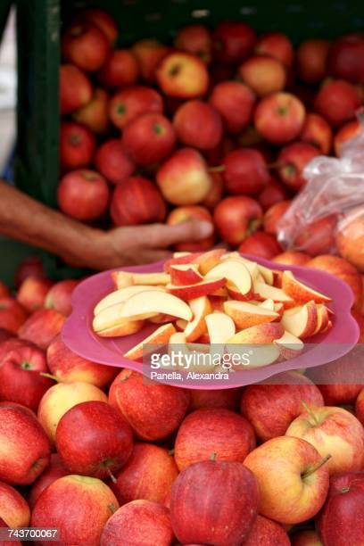 gala royal apples and slices for tasting - royal gala apple stock photos and pictures