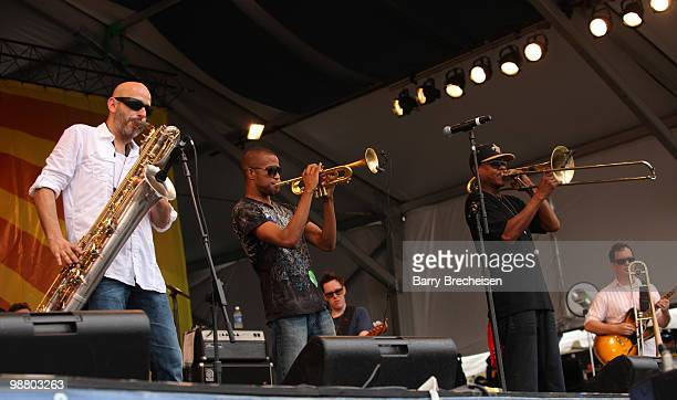 Galactic's Ben Ellman, Trombone Shorty and Galactic's Cory Henry perform during Day 6 of the 41st annual New Orleans Jazz & Heritage Festival at the...