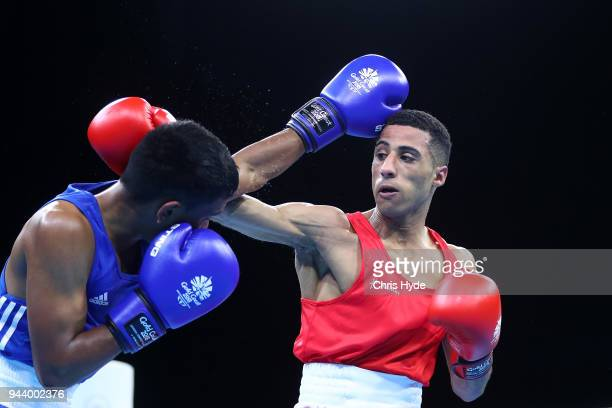 Galal Yafai of England and Sharvin Kumar Beedassee of Mauritius compete in the Men's 4649kg Quarterfinal during Boxing on day six of the Gold Coast...