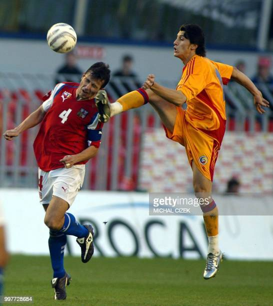 Galasek Tomas from Czech Republic vies with Marica Ciprian from Romania during their group one World Cup 2006 qualifying football match in Prague 09...