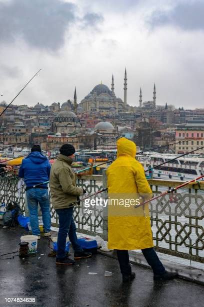 Galata bridge and disitrict in Istanbul with people fishing from the bridge