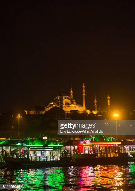 Galata bridge restaurants with Suleymaniye mosque in the back at night Marmara Region Istanbul Turkey on April 28 2014 in Istanbul Turkey