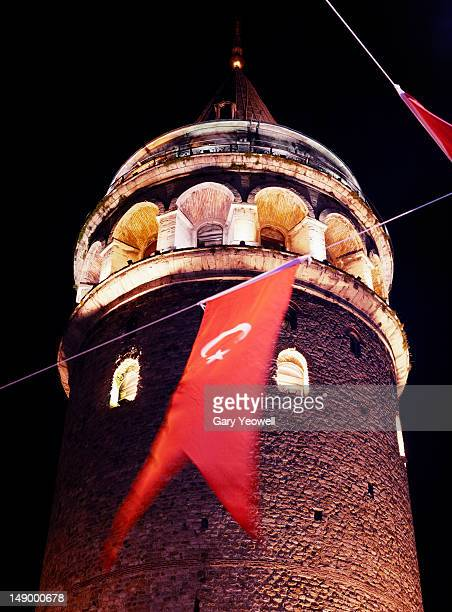 Galata Tower with Turkish flag at night
