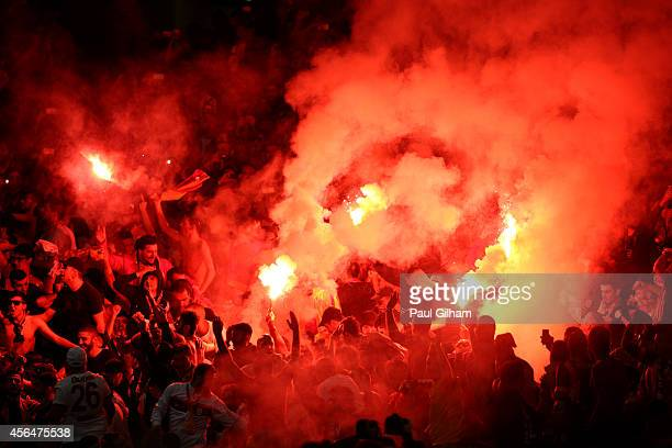 Galatasaray AS light flare after conceding a second goal during the UEFA Champions League group D match between Arsenal FC and Galatasaray AS at...