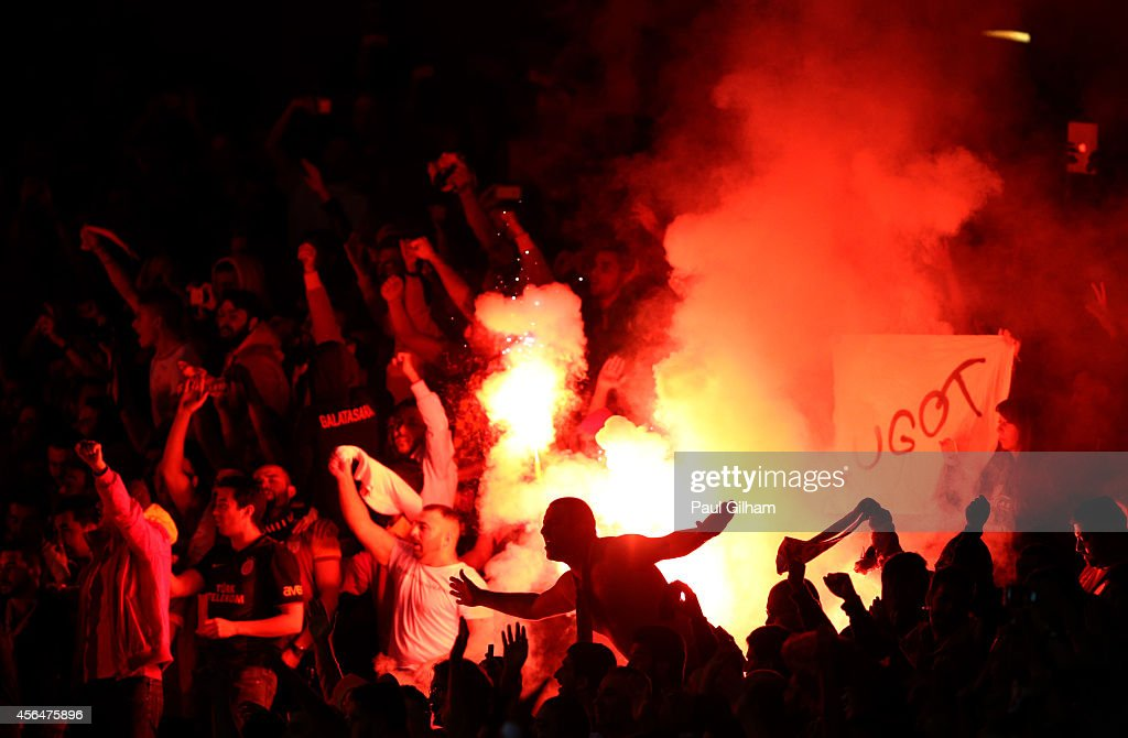 Galatasaray AS light flare after conceding a second goal during the UEFA Champions League group D match between Arsenal FC and Galatasaray AS at Emirates Stadium on October 1, 2014 in London, United Kingdom.