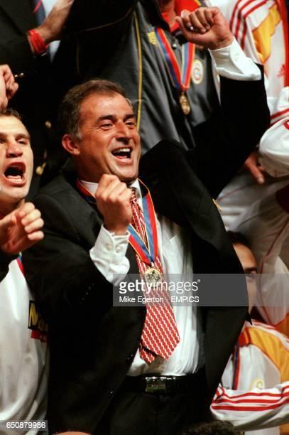 Galatasaray coach Fatih Terim celebrates winning the UEFA Cup