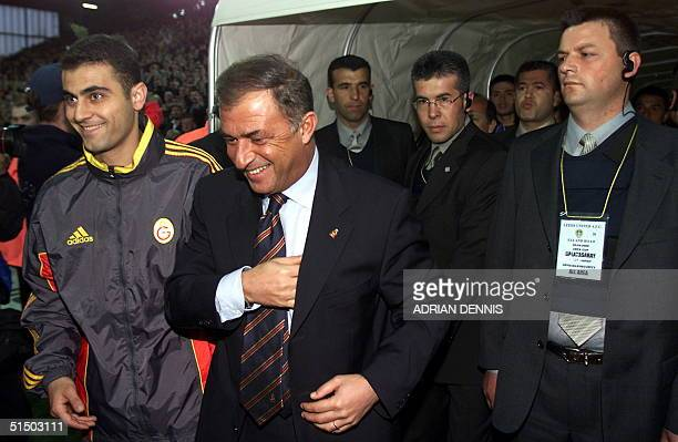 Galatasaray Coach Terim Fatih walks onto the field under the gaze of Turkish security guards before the UEFA Cup semifinal second leg at Elland Road...