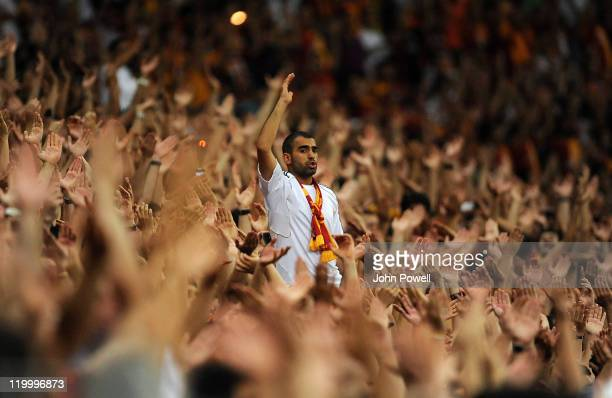 Galatasaray fan stands up in a sea of hands during a pre-season friendly match between Galatasaray and Liverpool at Turk Telekom Arena on July 28,...