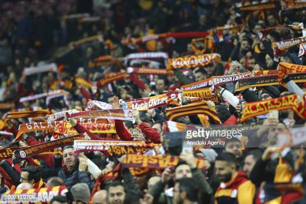Galatasaray fans chant during Turkish Super Lig soccer match between Galatasaray and Trabzonspor at Turk Telekom Stadium in Istanbul Turkey on...